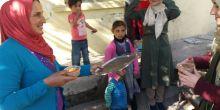 Kazan imam hatipli öğrenciler Suriyeli ailelere aşure ikramında bulundu